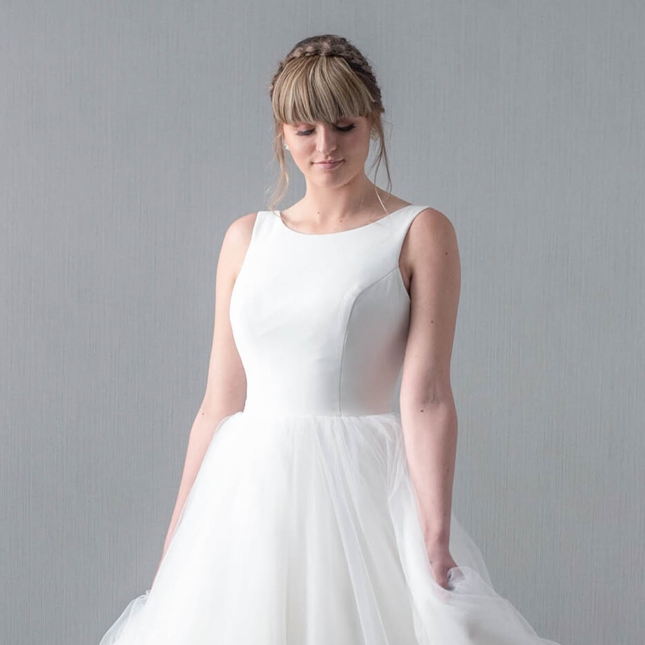 Model wearing white ballgown dress