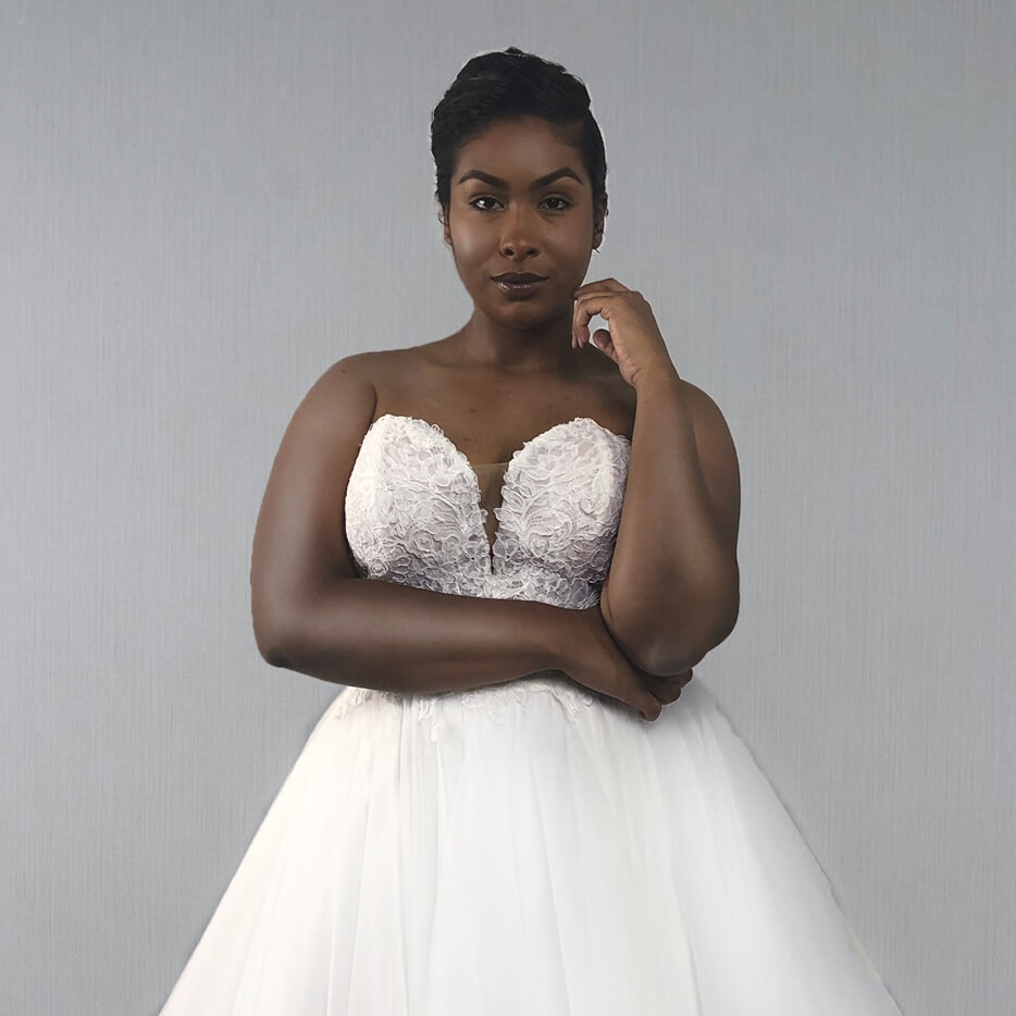 Plus Size Model wearing white wedding dress
